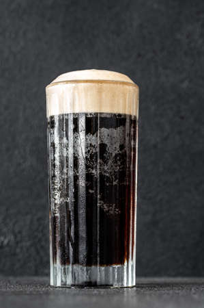 Glass of black velvet cocktail made from a combination of stout and champagne Reklamní fotografie