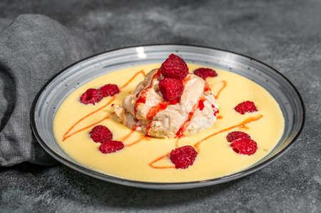 Floating island dessert made of meringue floating on vanilla custard 스톡 콘텐츠