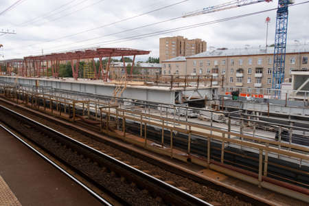 Construction of a new railway platform at Okruzhnaya station in Moscow, visible concrete structures