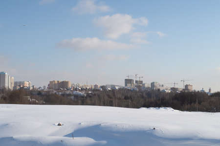 New sleeping areas and new buildings in the Moscow region, snow fields, background