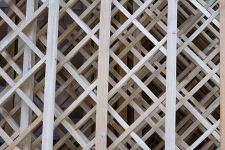 Volumetric structure of thin wooden slats, openwork background