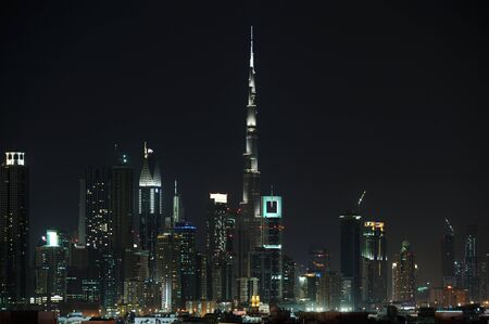 world trade: Dubai World Trade center and Burj Khalifa an night. Editorial
