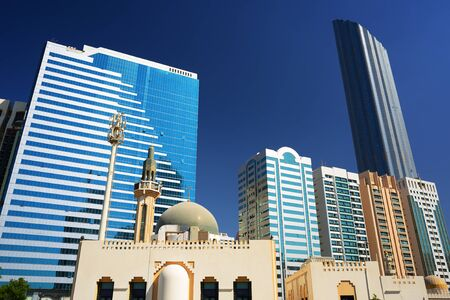 abudhabi: Mosque on the background of skyscrapers in Abu-Dhabi.
