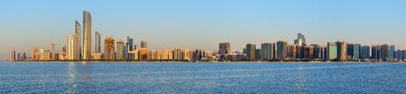 Abu Dhabi cityline at sunset.