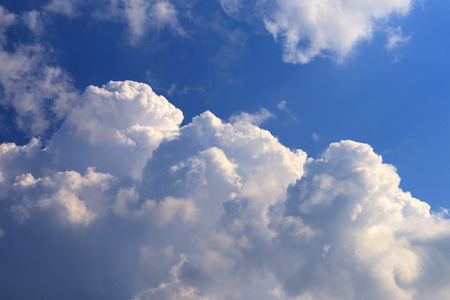 White clouds on the blue sky background. Stock Photo