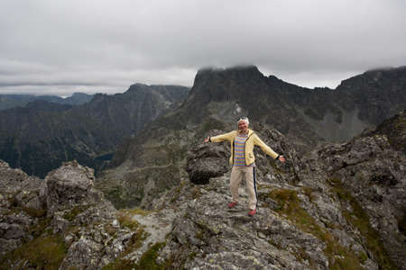 Backpacker girl tourist exploring the Tatra mountains national park, Poland.