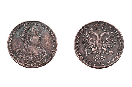other side of: Russian one rouble coin of 1727 years. The Ekaterina First portrait on one side, and two headed eagles with crown on the other. Stock Photo