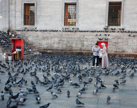eminonu: Yeni Cami in Eminonu neighborhood of Istanbul, Turkey. Square full of pigeons. Editorial