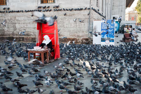 Yeni Cami in Eminonu neighborhood of Istanbul, Turkey. Square full of pigeons. Editorial