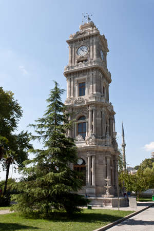Clock Tower near Dolma Bahche Palace, Istanbul, Turkey. photo