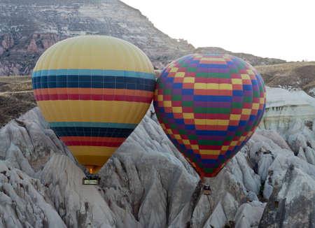 Hot air balloon over rock formations in Cappadocia, Turkey photo