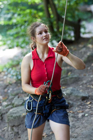 Rock climbing on the nature with rope. photo