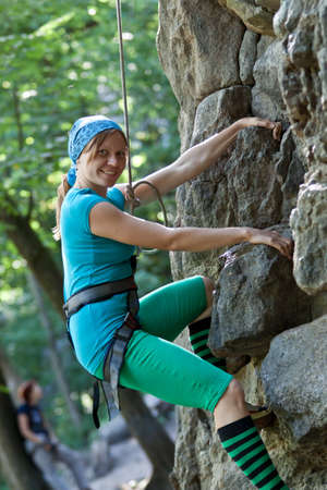 Rock climbing on the nature with rope. Stock Photo - 13024277