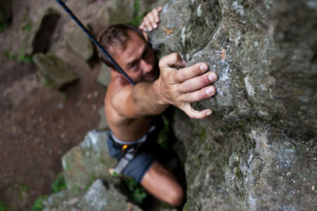 Rock climbing on the nature with rope. Stock Photo - 13087785