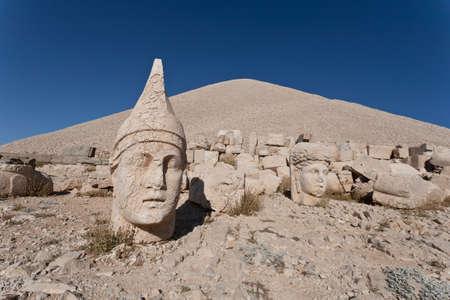 toppled: Toppled heads of the gods at the top of Nemrut dagi in Turkey