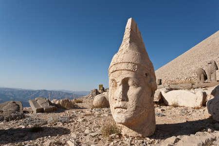 toppled: Toppled heads of the gods at the top of Nemrut dagi in Turkey.