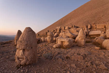Toppled heads of the gods at the top of Nemrut dagi in Turkey. Stock Photo - 13283132