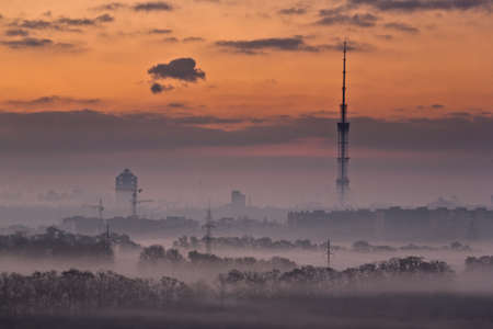Urban landscape at misty morning in Kyiv, Ukraine. photo