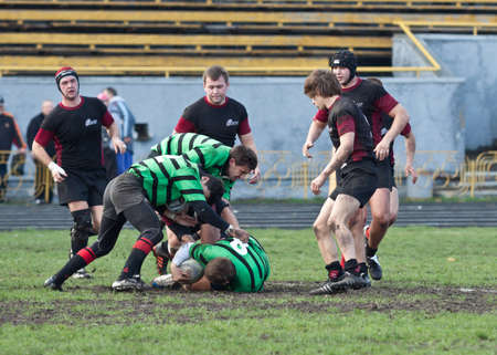 ANTARES - EGER, UKRAINE, KIEV - NOVEMBER 4 : Rugby players in action at a Ukrainian National Championship Final rugby match, Antares(in green) vs. Eger(in black), November 4, 2012 in Kiev, Ukraine.
