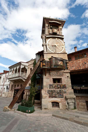 Slanted clock tower at puppets square - Tbilisi, Georgia