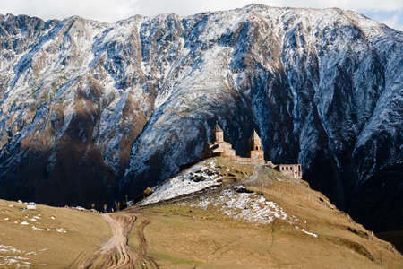 Tsminda Sameba near the Kazbegi-Gergeti village, Georgia. Reklamní fotografie