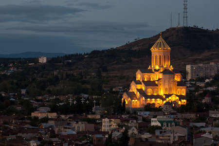 Night view of St. Trinity cathedral in Tbilisi, Georgia photo