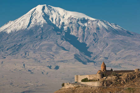 Ancient Armenian church Khor Virap with Ararat on the background  photo