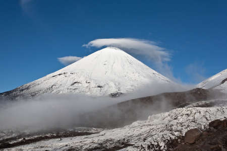 Cloud cap on the top of volcanoe Klyuchevskaya located on Kamchatka region, Russia