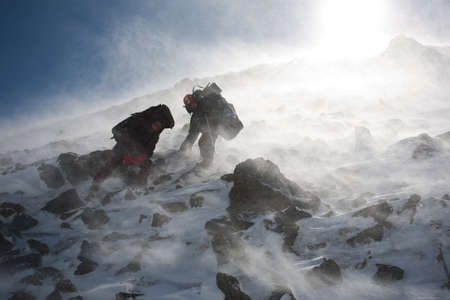 Hikers moving in snowy Kamchatka region, Russia