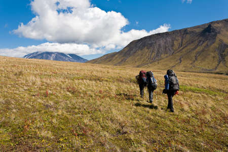 kamchatka: Hikers moving in snowy Kamchatka region, Russia.