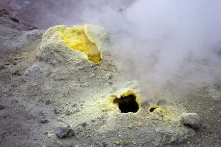 Volcanic vents with smoke, sulphur and ash on Kamchatka. Stock Photo - 17109415
