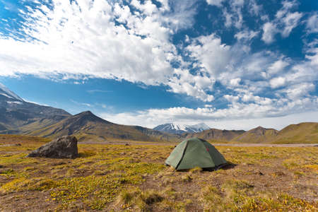 Tent with deep blue sky located on Kamchatka, Russia