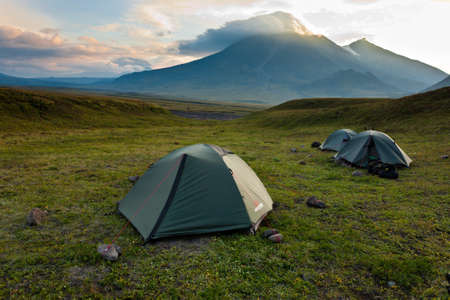 Volcano landscape with tents on Kamchatka, Russia. photo
