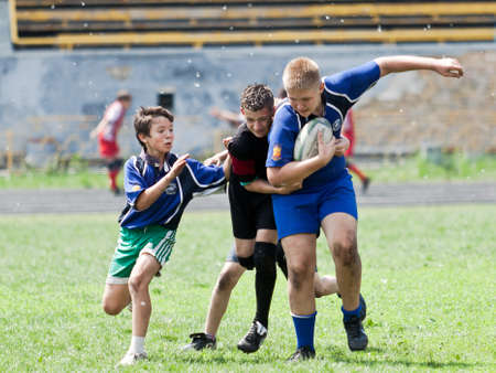 X RUGBY KIDS TOURNAMENT, UKRAINE, KIEV – MAY 19 : Mixed kid teams of mixed rugby players from all over the Ukraine in action at a X Kids Tournament on May 19, 2013 in Kiev, Ukraine. Editorial