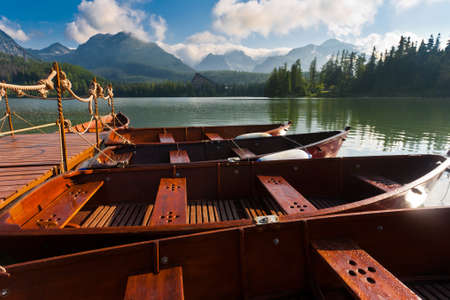 Boats on mountain pond near tatra mountains, Slovakia. photo