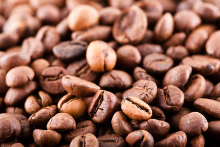 Coffee beans abstract background close macro shot. photo