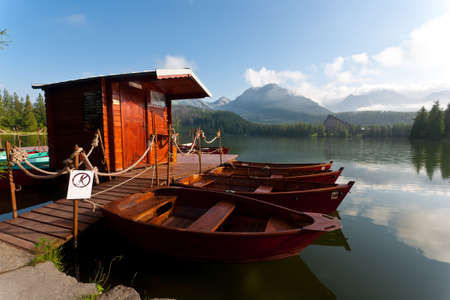Boats on pond at tatra valley, Slovakia  photo