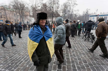 KIEV, UKRAINE - 21 JANUARY 2014  Unknown demonstrators at the Independence square during Ukrainian revolution on January 21, 2014 in Kiev, Ukraine  Stock Photo - 25219477