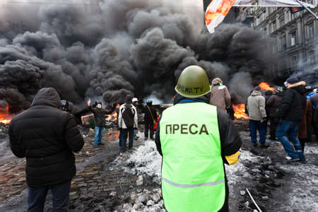 KIEV, UKRAINE - 23 JANUARY 2014: Unknown demonstrators at the Independence square during Ukrainian revolution on January 23, 2014 in Kiev, Ukraine. Redakční