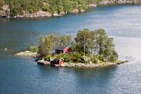 fishing hut: Typical fishing hut on island in Norway. Stock Photo