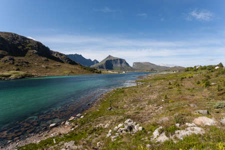 Norway landscape with fjords and deep blue sky.