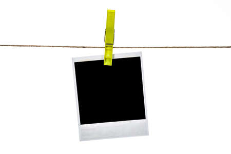 Black instant photo, hanging on the clothesline, isolated on white background. photo