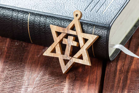 zionism: Jewish symbol star of david, on wooden background.