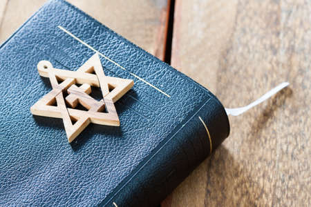 jewish star: Jewish symbol star of david, on wooden background.