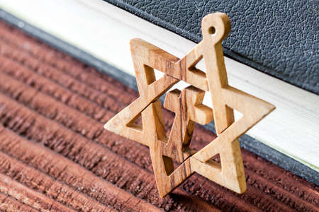 zionism: Jewish symbol star of david, on wooden background.