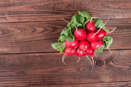 radishes: Radishes on rustic wooden background