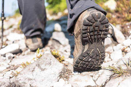 wellfare: Close view of hiker boots, travel background.