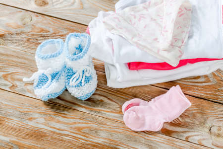 Baby clothing on a wood background