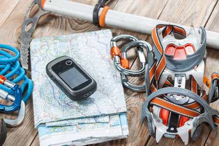 crampon: Equipment for mountaineering and hiking on wooden background.