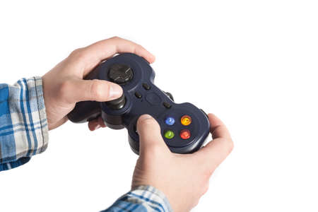 Joystick in hands. He like play and win video games.Isolated on white. Stock Photo